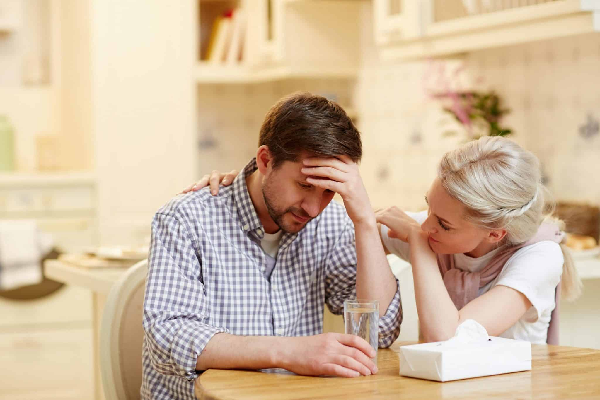 Woman tending to her depressed spouse