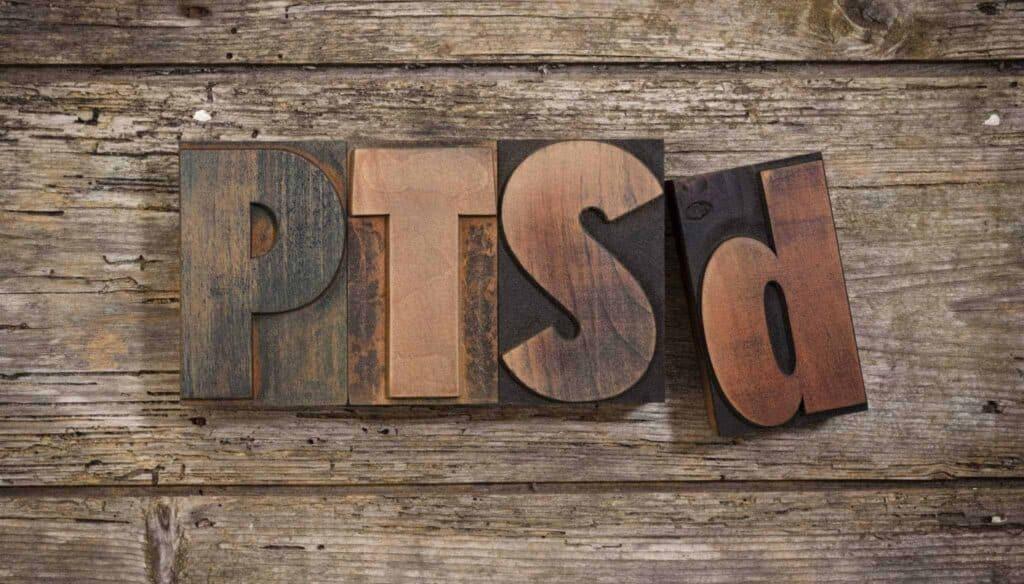 Wooden alphabetical blocks spelling PTSD