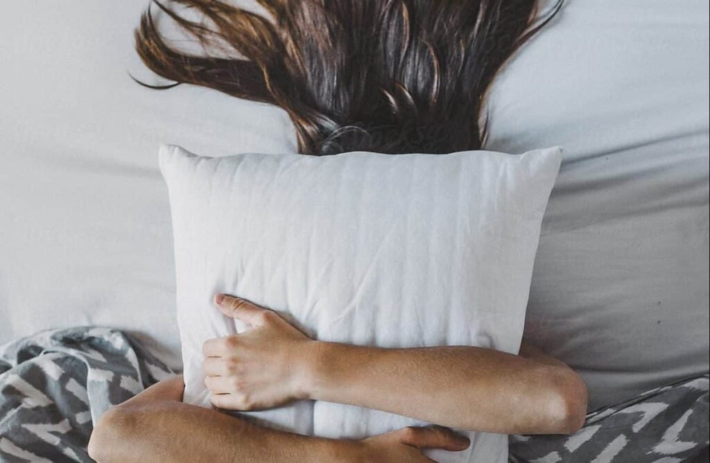 female suffering from insomnia due to stress