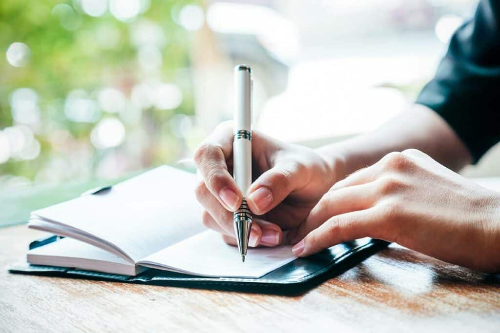 Woman journaling to help anxiety.