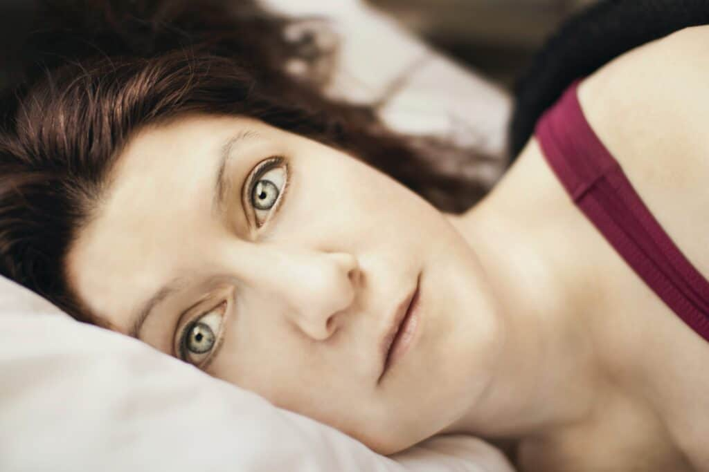 A woman is unable to sleep at night due to rumination