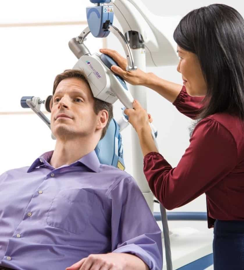 Patient undergoing TMS therapy