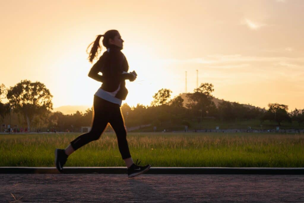 Woman running to improve her overall wellbeing